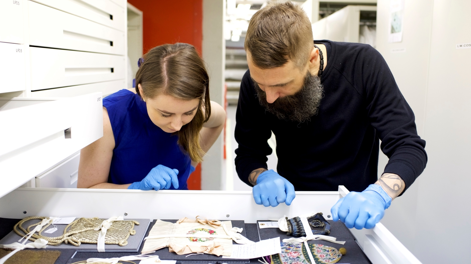 Timothy A. Long, Curator of Fashion & Decorative Arts and Dr Danielle Thom, Curator of Making, inside the Costume Store at the Museum of London