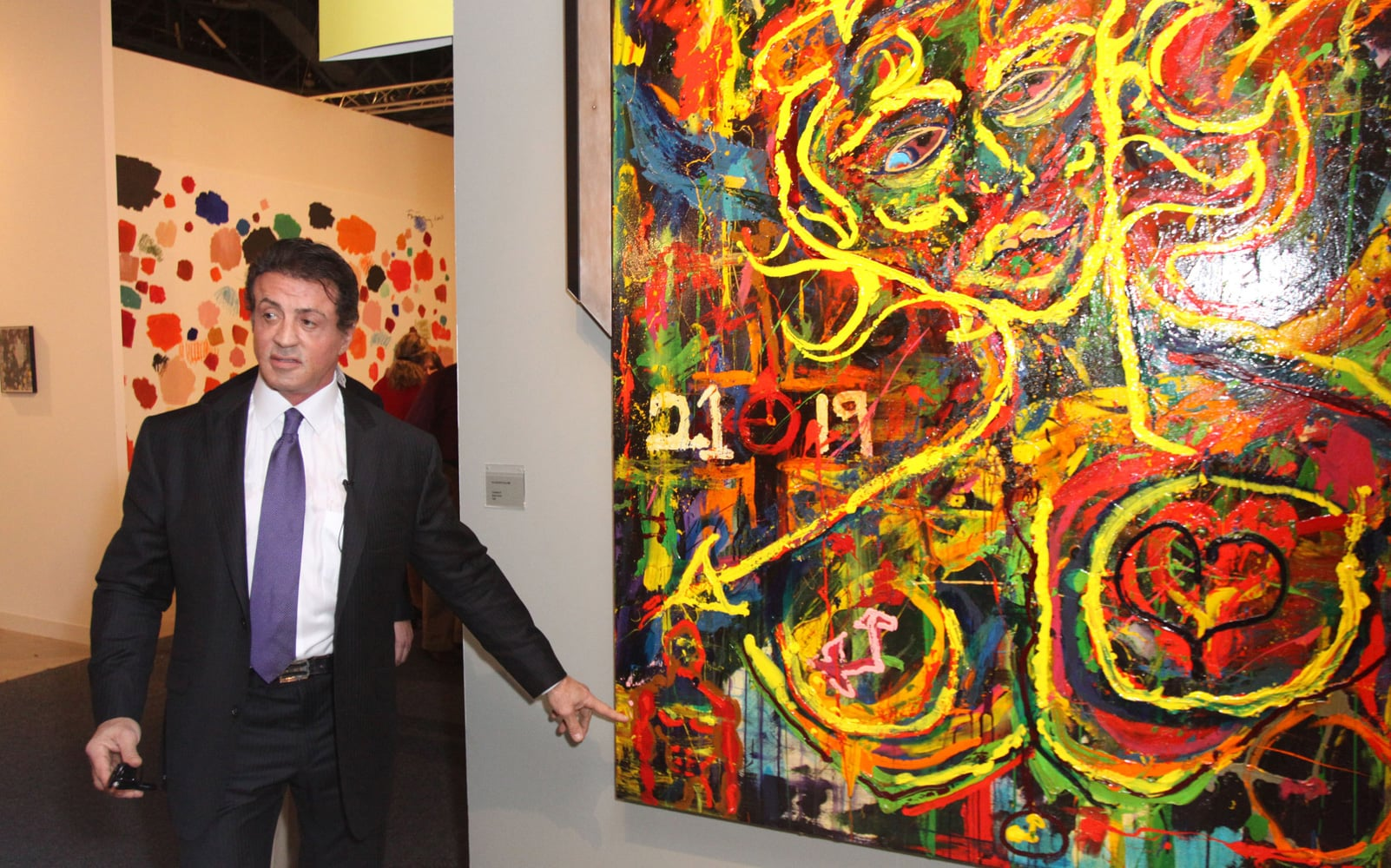Sylvester Stallone poses with a masterpiece -