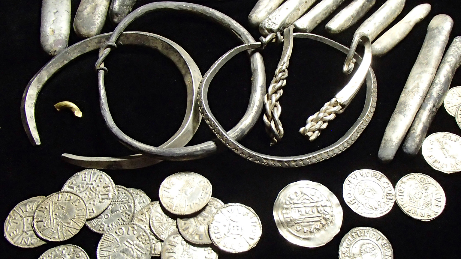 Selection of items from the Watlington Hoard showing the range of objects discovered: arm-rings, ingots, coins and cut-up pieces of silver and gold