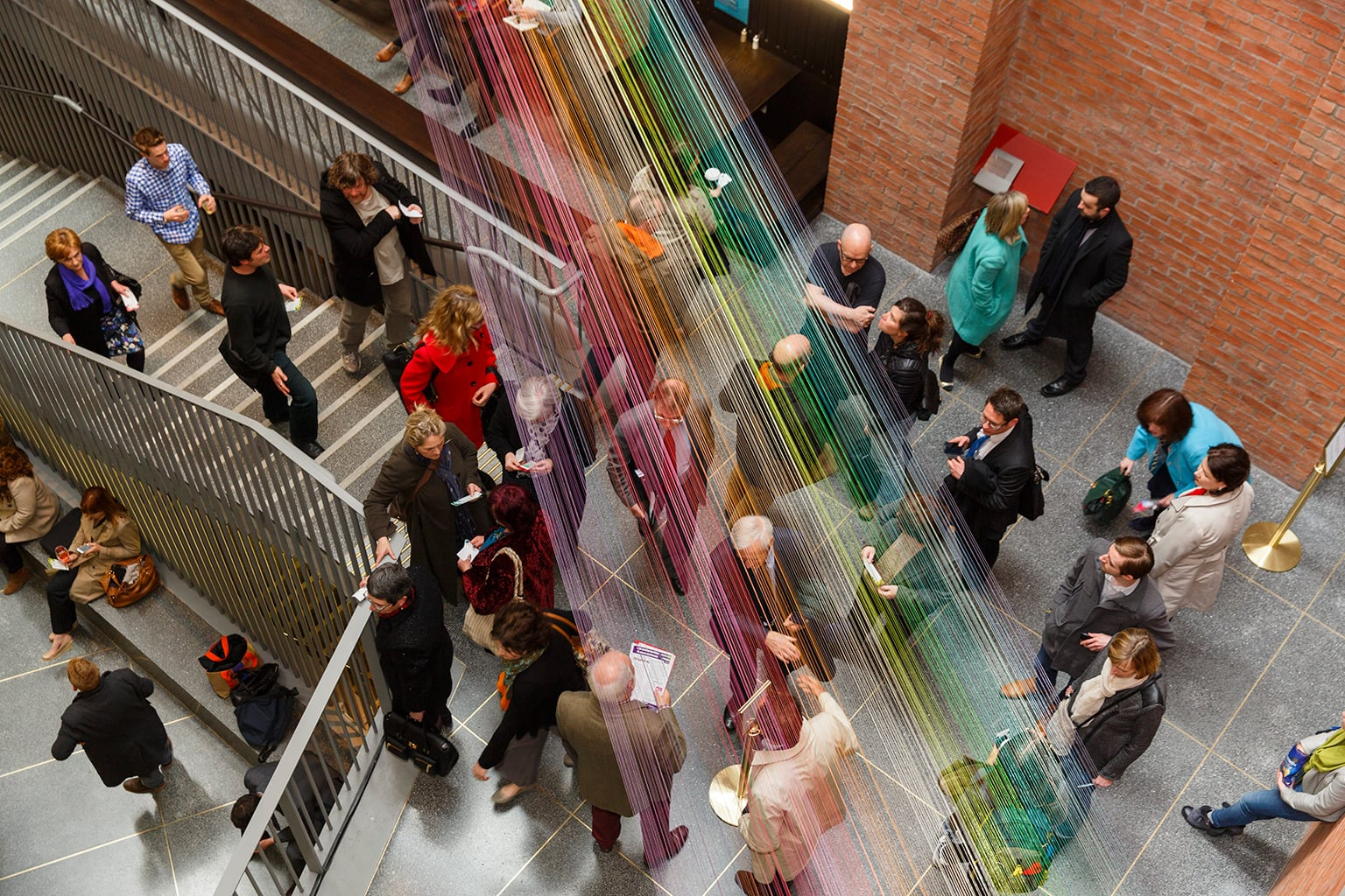 Visitors pictured under the Permanent Present, the only permanent artwork at the MAC