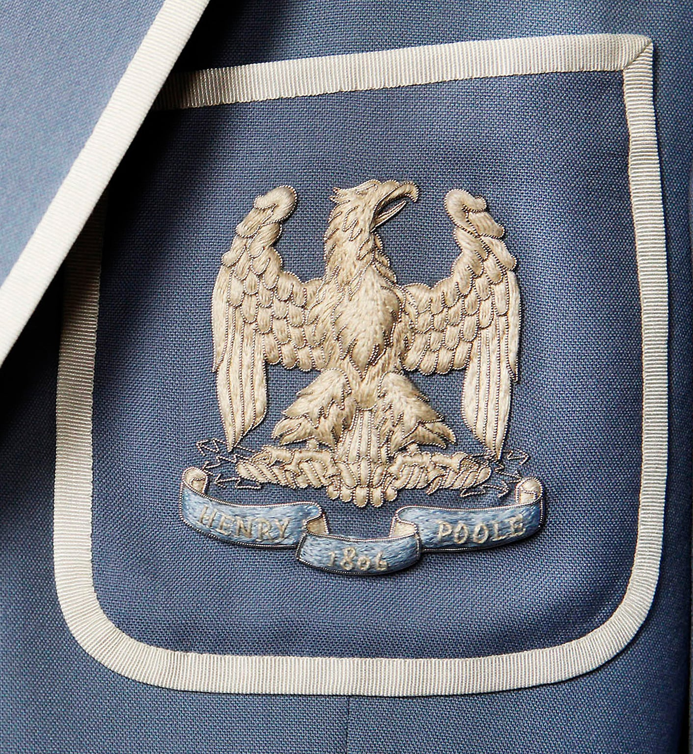 Wedgwood blue blazer with Napoleonic eagle embroidered on the outbreast patch