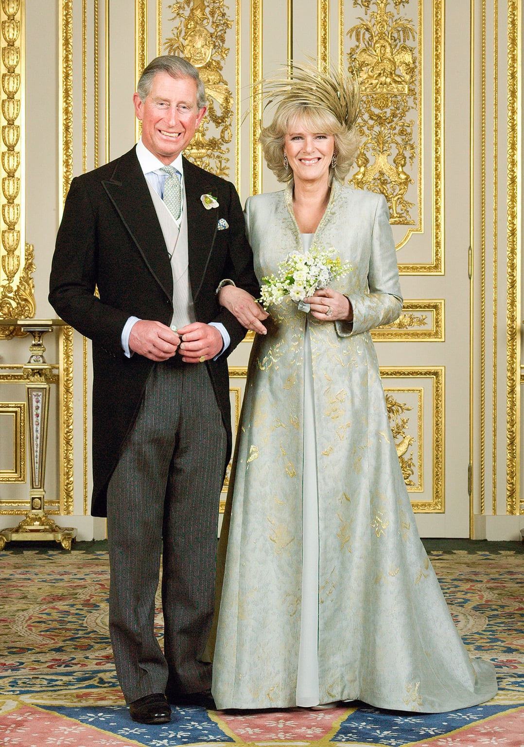 Embroidered silk coat and silk dress designed by Anna Valentine, feather headdress created by Philip Treacy. Worn by The Duchess of Cornwall for the blessing after her marriage to HRH The Prince of Wales, 2005.