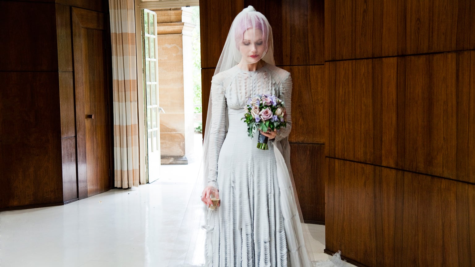 Pale grey slashed chiffon wedding dress and veil designed by Gareth Pugh. Worn by Katie Shillingford for her marriage to Alex Dromgoole, 2011