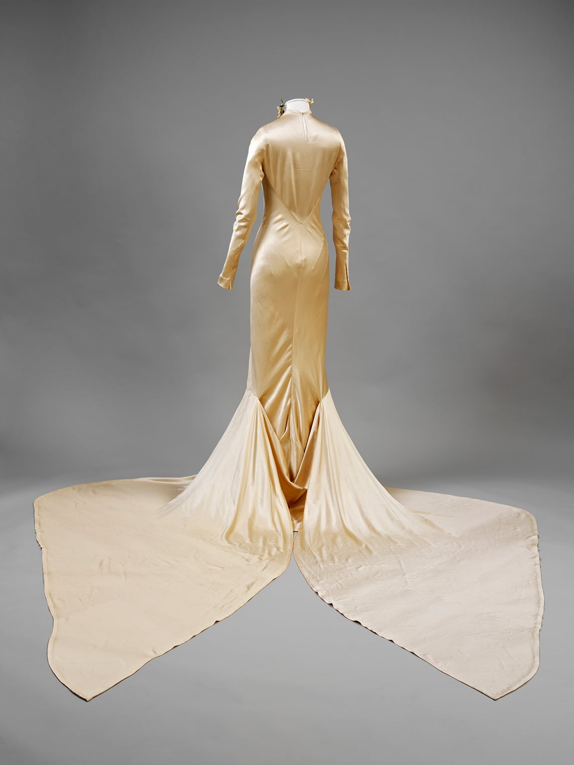 Silk satin wedding dress designed by Charles James, London. Worn by Barbara 'Baba' Beaton for her marriage to Alec Hambro. Given by Mrs Alec Hambro ,1934