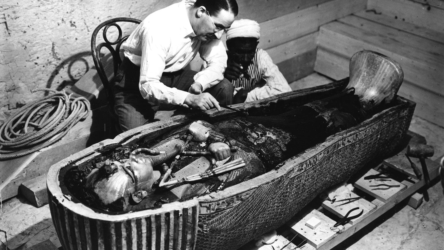 Howard Carter and unnamed Egyptian assistant inspect Tutankhamun's inner-most coffin, Photo by Harry Burton, 1922
