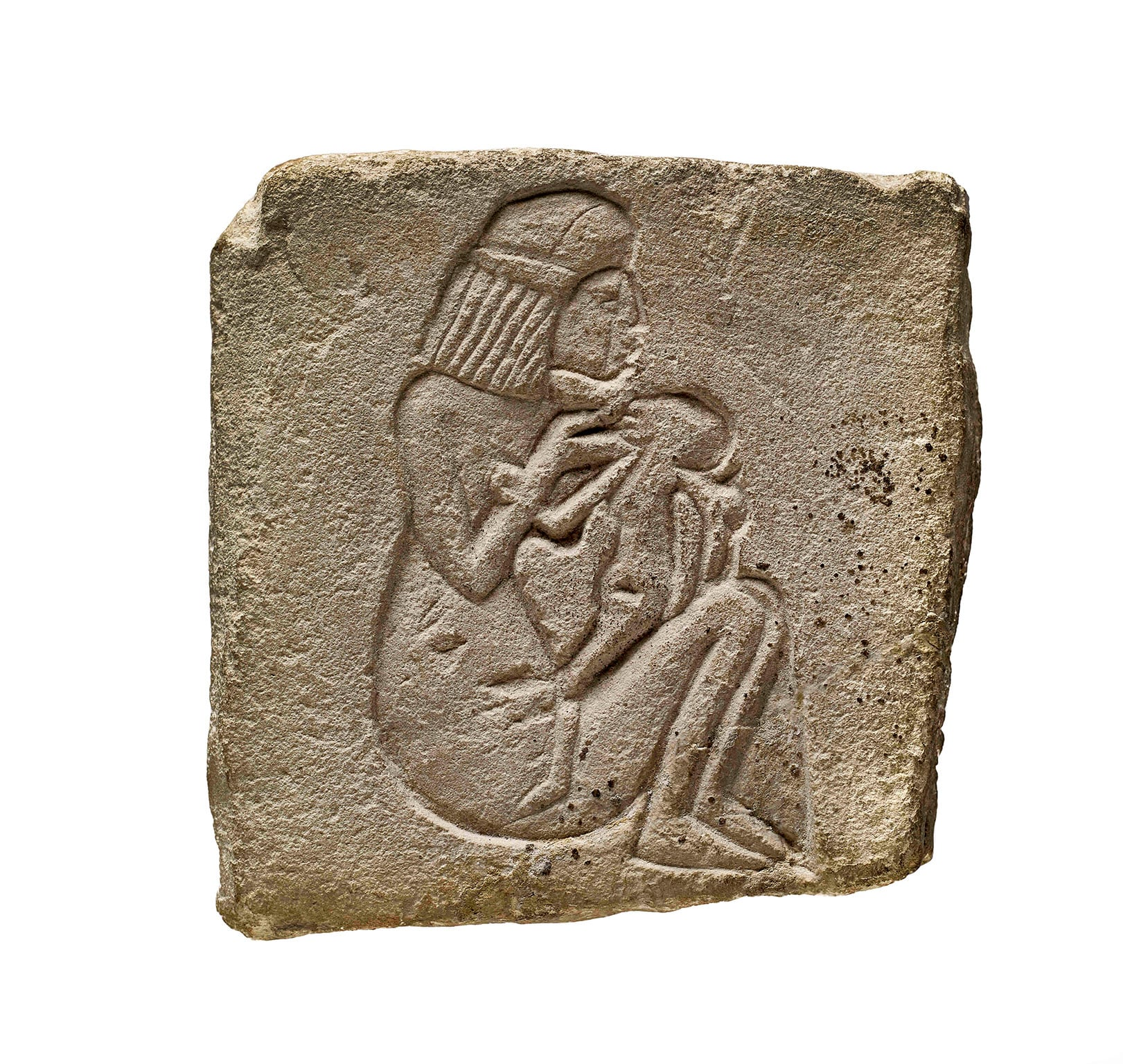 Limestone stele decorated with a representation of a woman suckling a child. 18th Dynasty