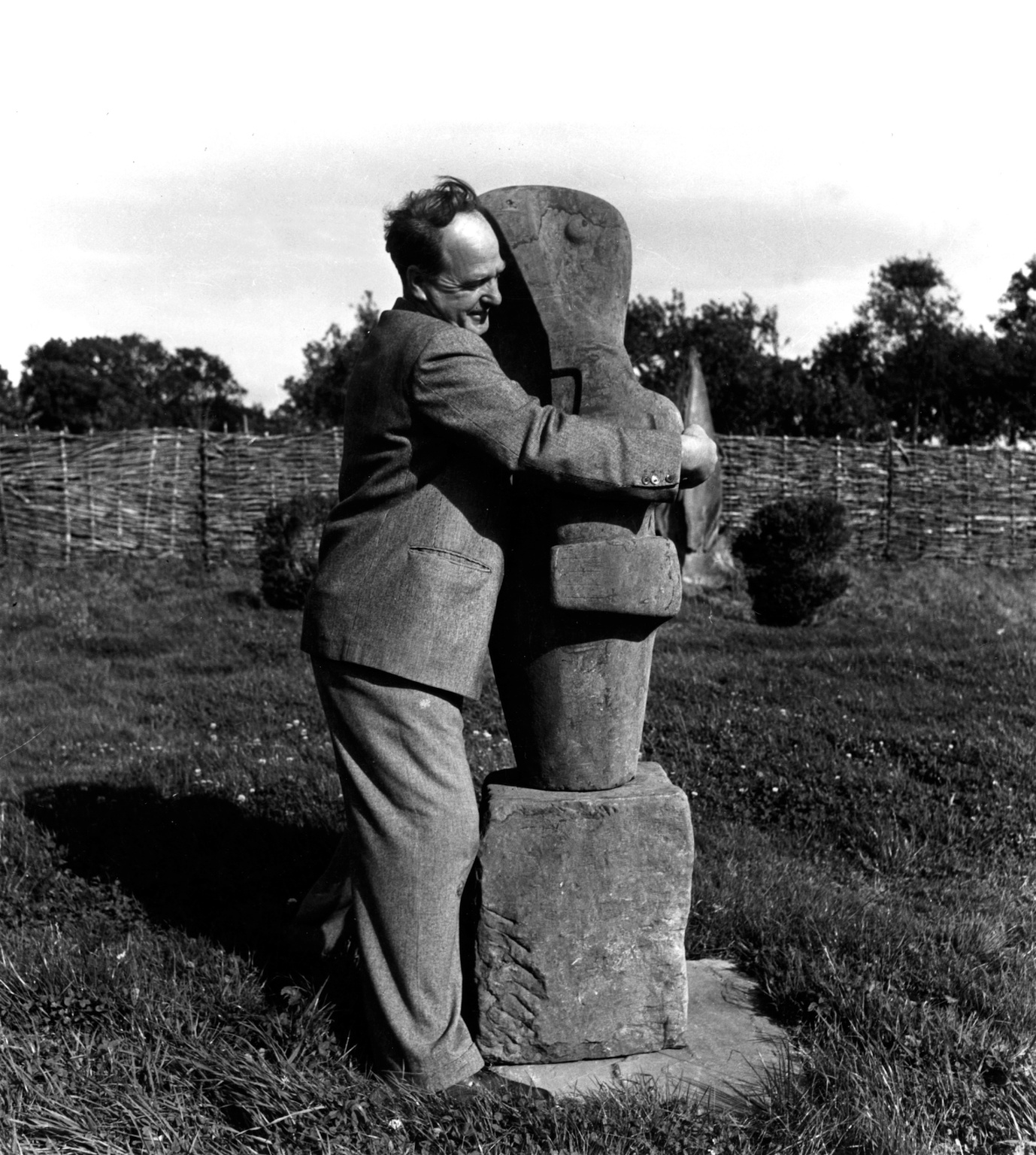 Lee Miller, Henry Moore with his sculpture Mother and Child, Farleys Garden, East Sussex, 1953