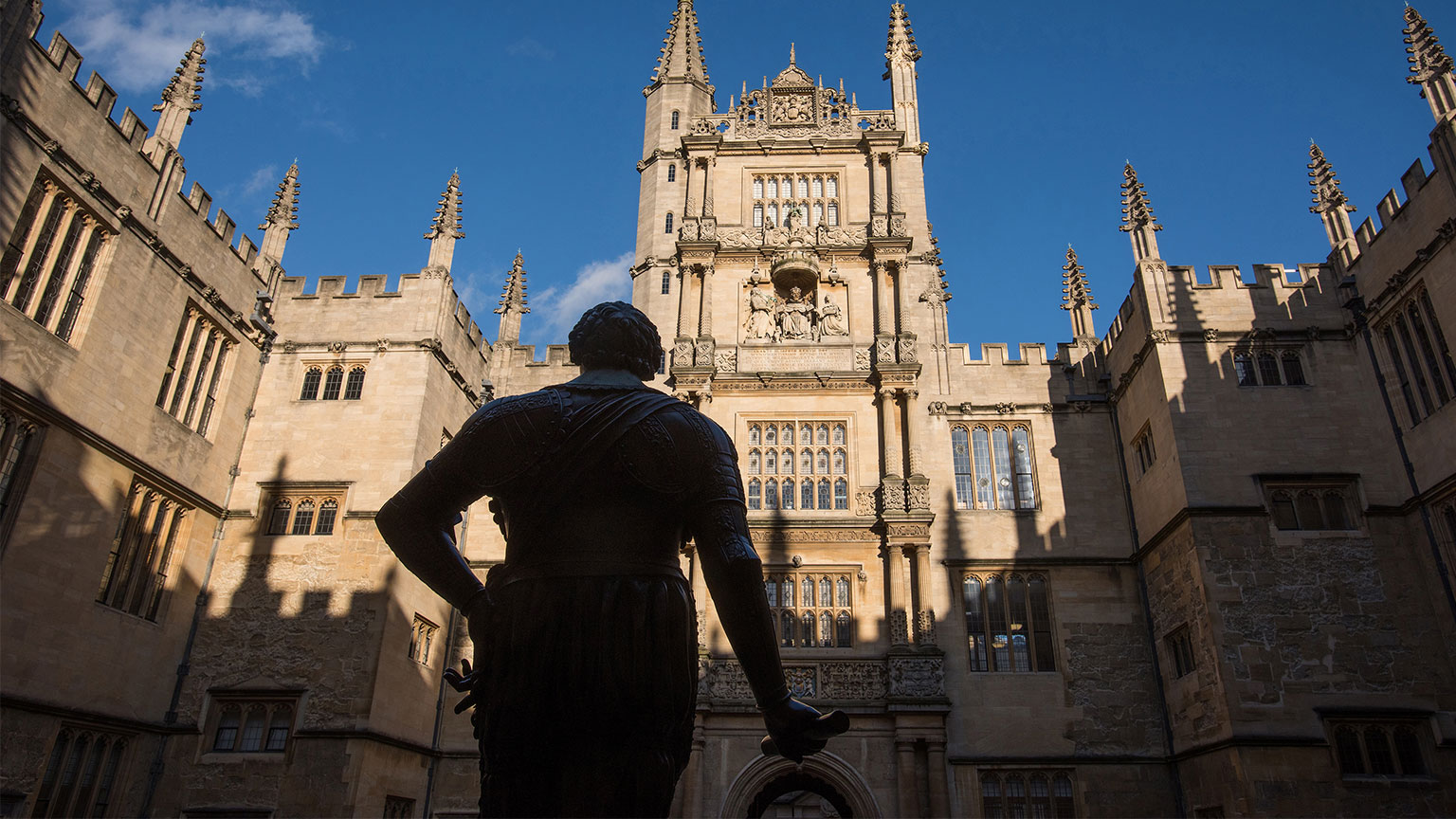 Silhouette of the Earl of Pembroke statue against the Bodleian Library Tower of Five Orders