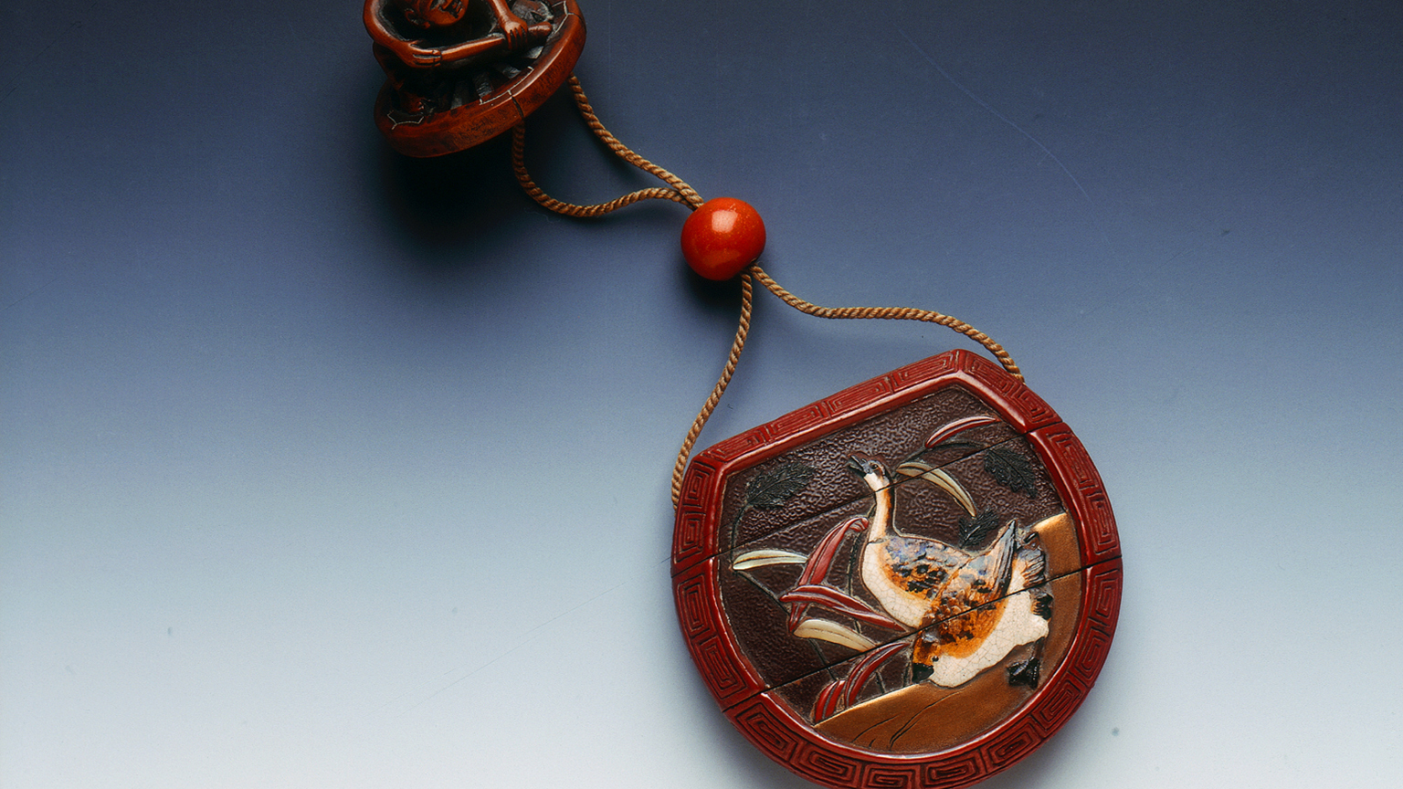 Lacquer inro with Daruma and geese in style of Ritsuo and ojime and wood netsuke of a wheelwright, signed 'Hokei'Japan, 18th century