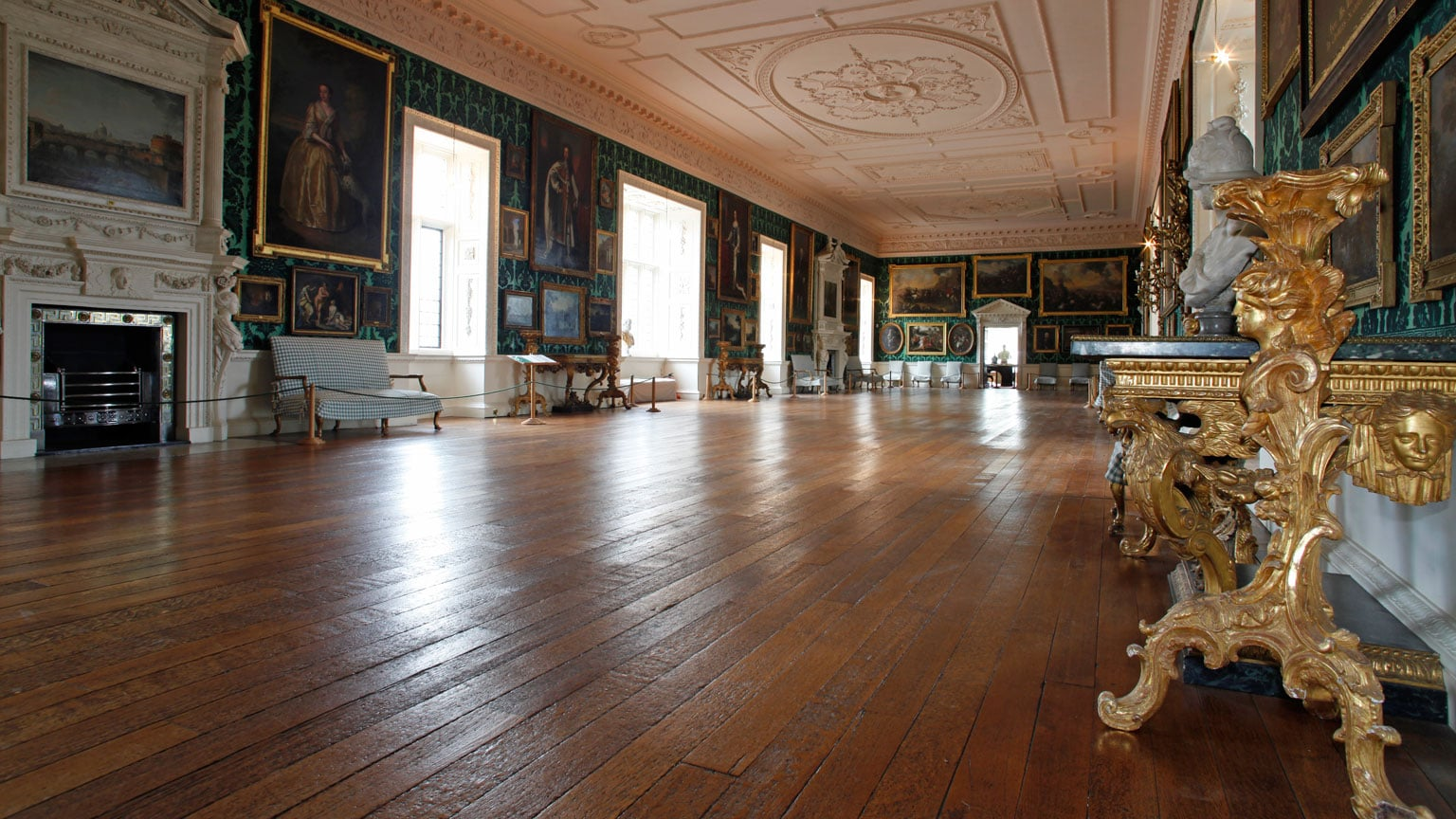 The green and gilt Picture Gallery, restored in 1996, with furniture by James Pascall on a mythological theme.