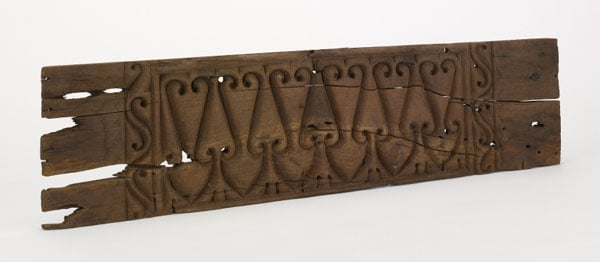 Four carved wooden panels
