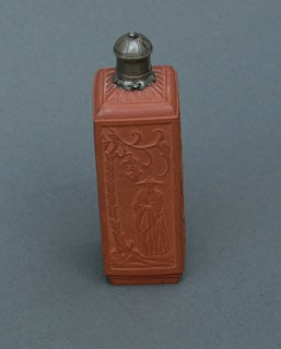 Red stoneware tea canister