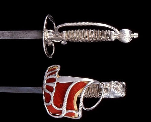 Two silver-hilted swords