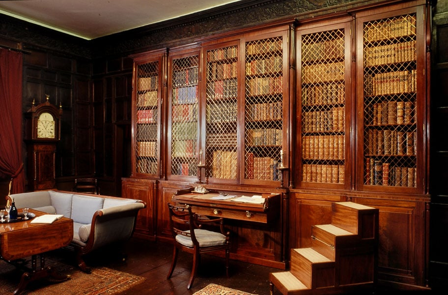 Secretaire bookcase, pair of sofas, & library steps