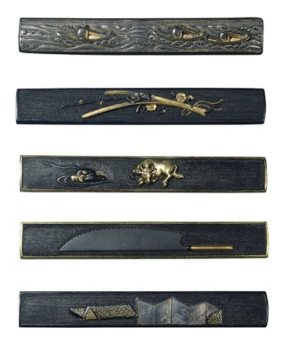 A collection of Japanese metalwork sword fittings