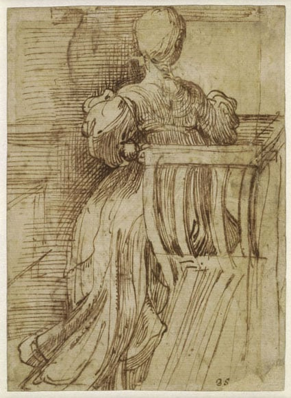 A seated woman seen from the back