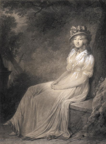 Portrait of a woman seated in a landscape