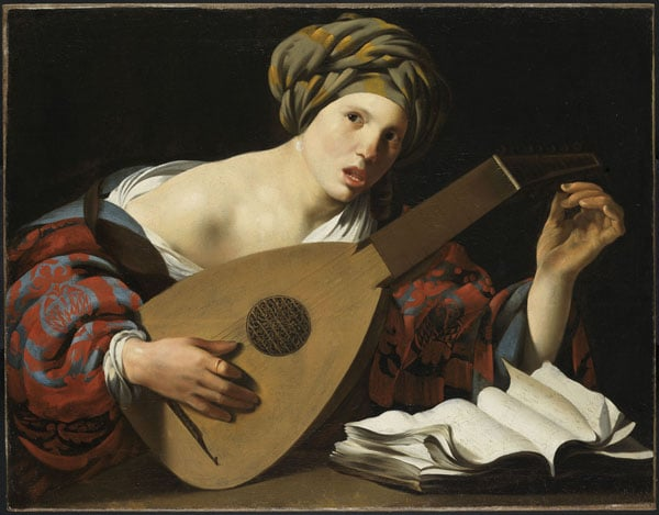 Young woman tuning a lute and singing