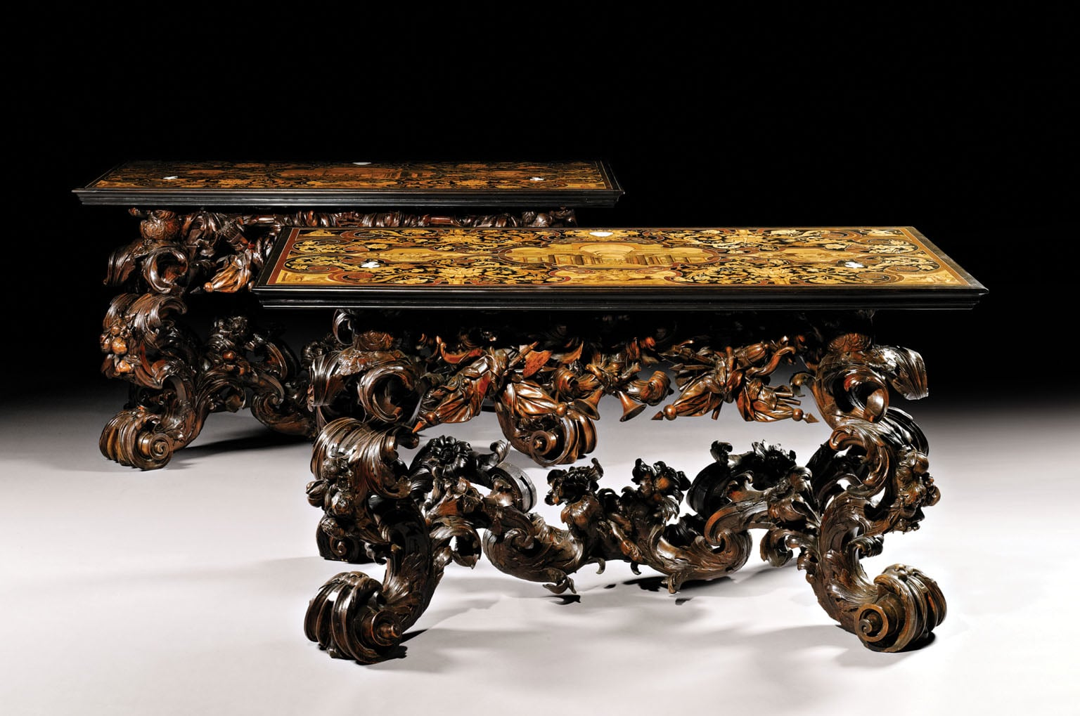 A pair of Venetian console tables