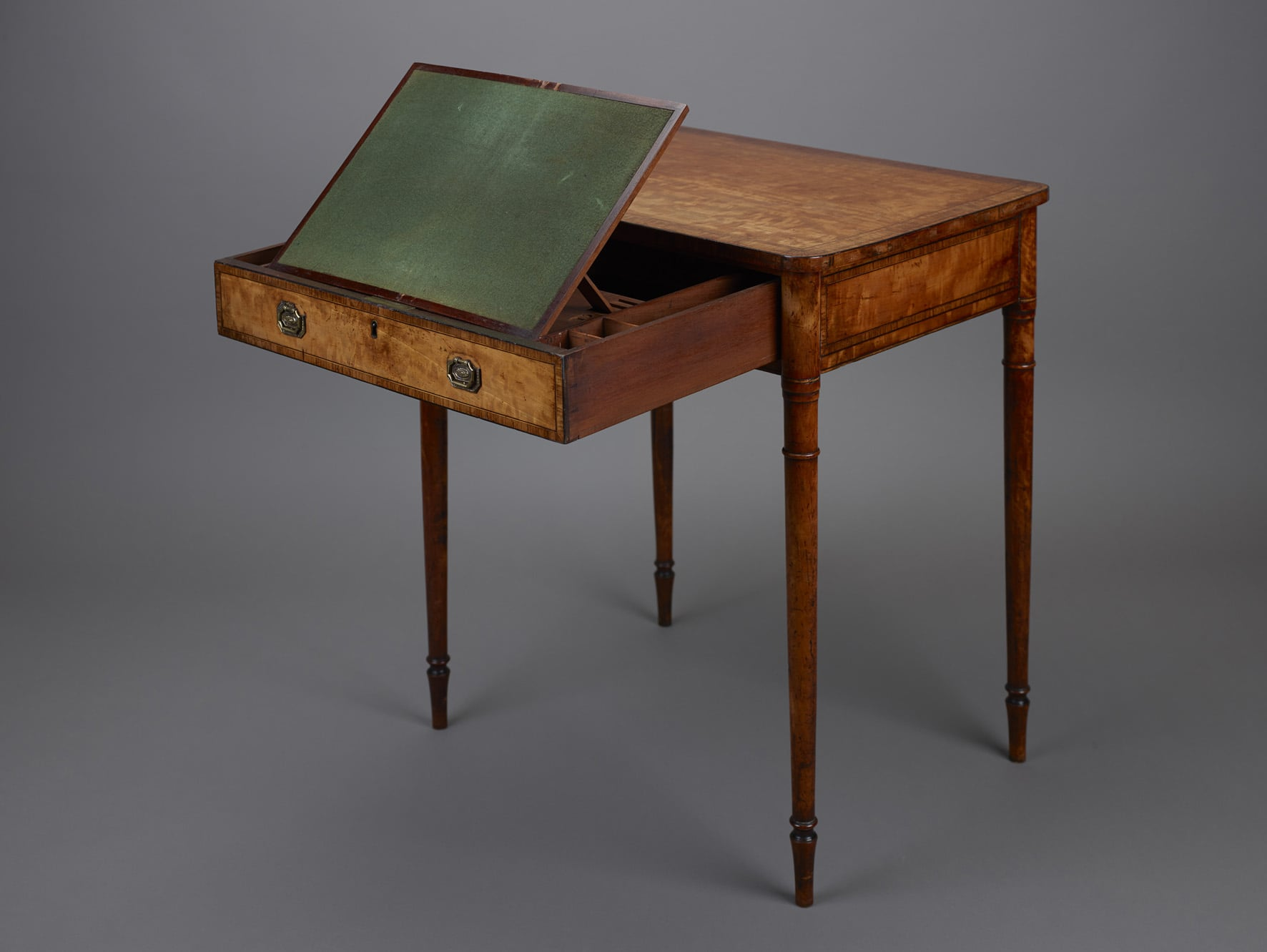A lady's satinwood writing table and giltwood and gesso pier glass mirror