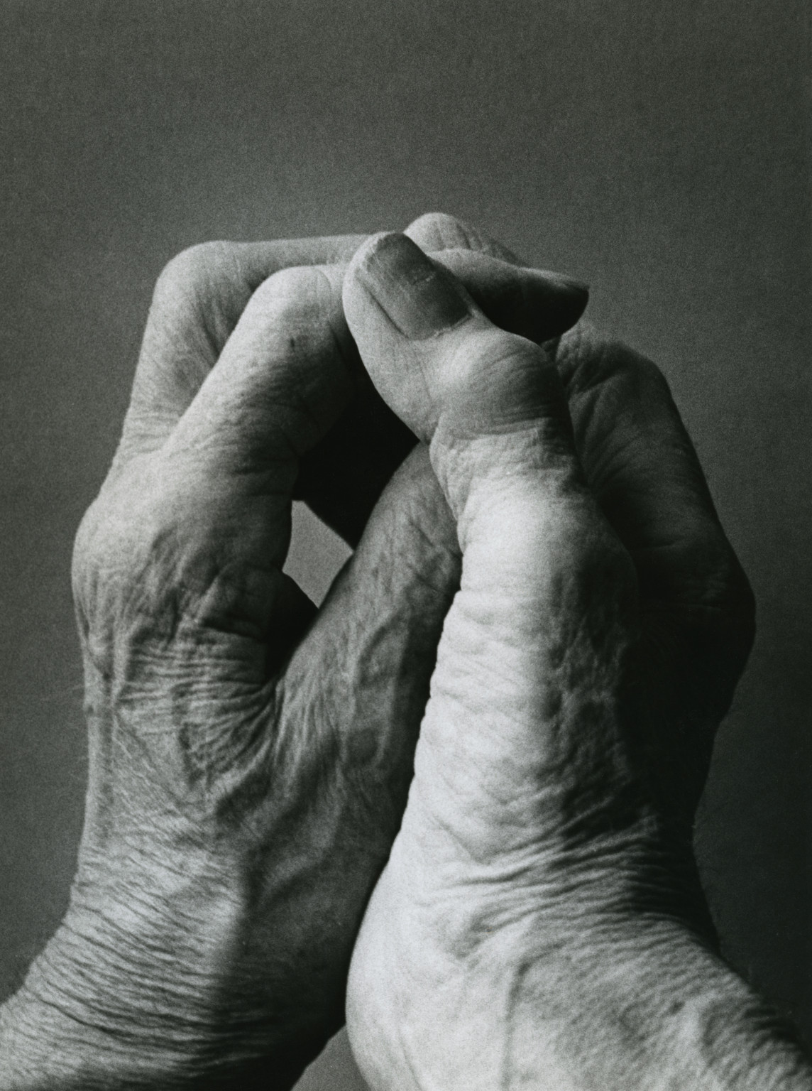 The artist's hands. This photograph is one of a large sequence taken at the request of Moore.