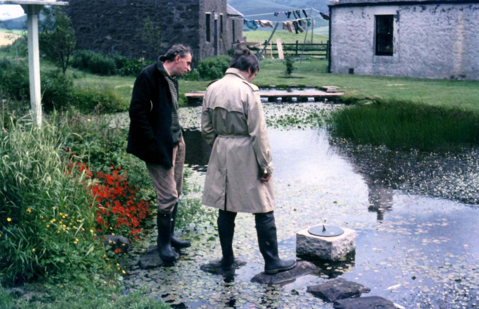 Ian Hamilton Finlay and Stephen Bann discussing the sundial, 'Tristram's Sail', installed in the House Pond at Stonypath, July 1972