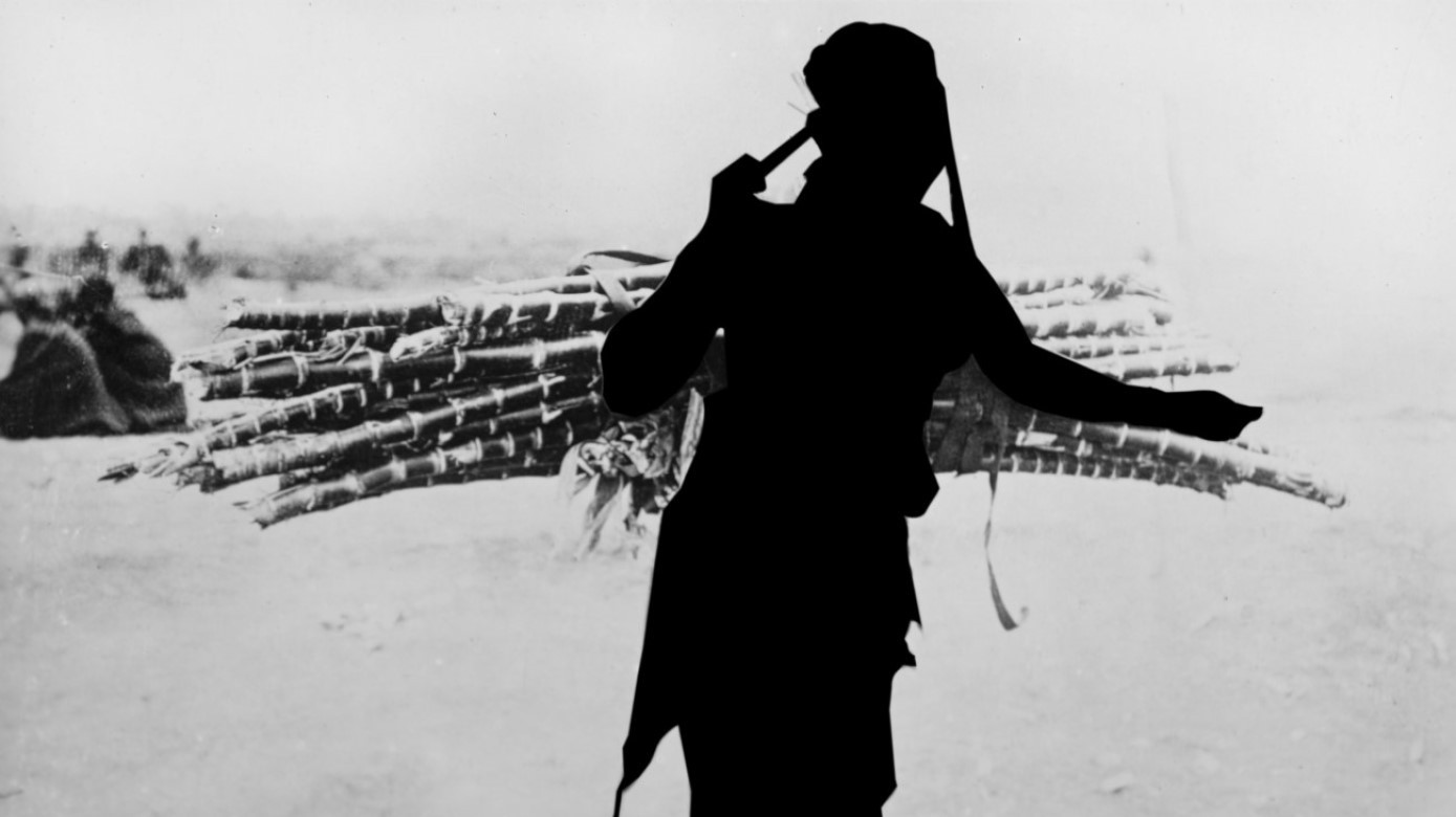 East African Woman Carrying Cane