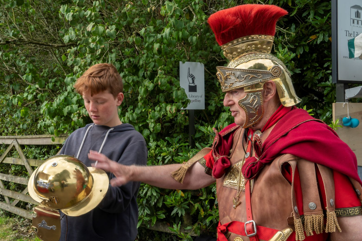Roman Renactor with visitor