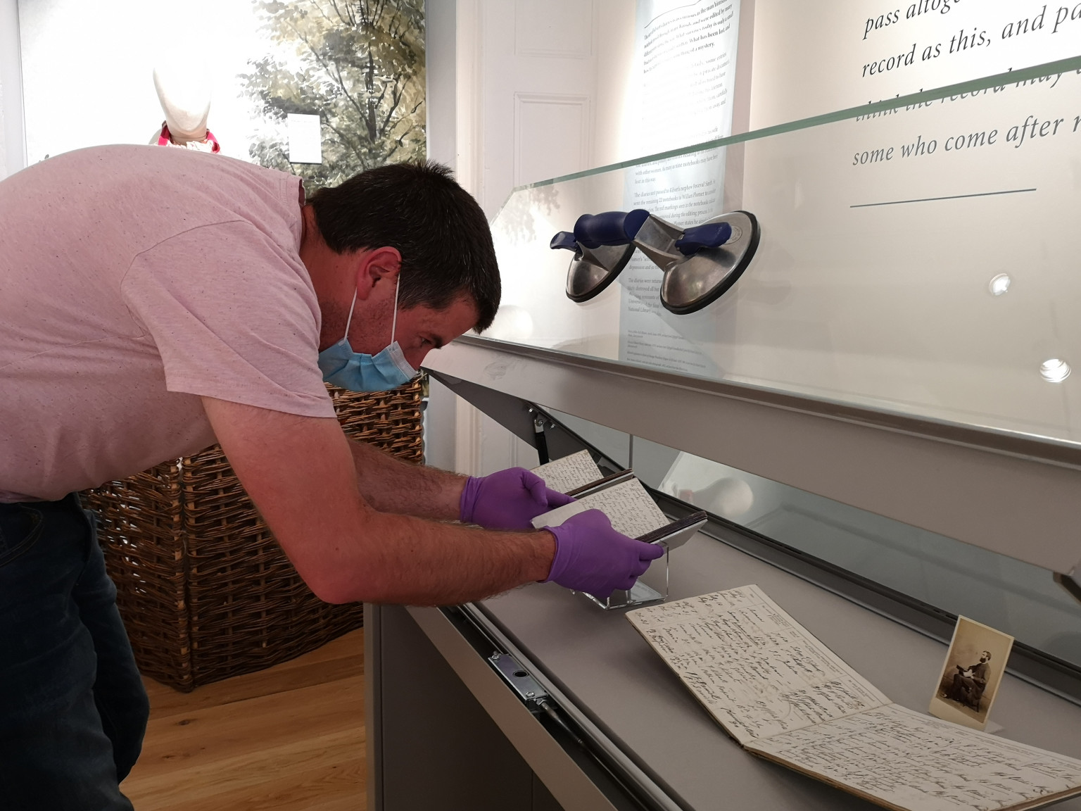 Two of the three surviving Kilvert diaries being installed at Chippenham Museum by Richard Edwards of The National Library of Wales.