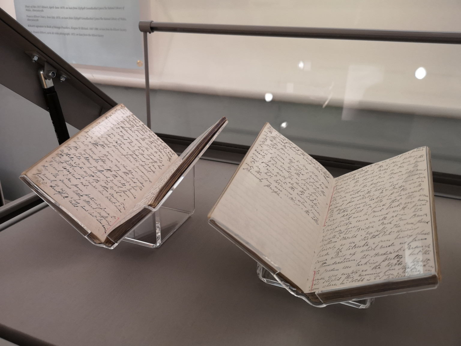 Two of the three surviving Kilvert diaries being installed at Chippenham Museum by The National Library of Wales.