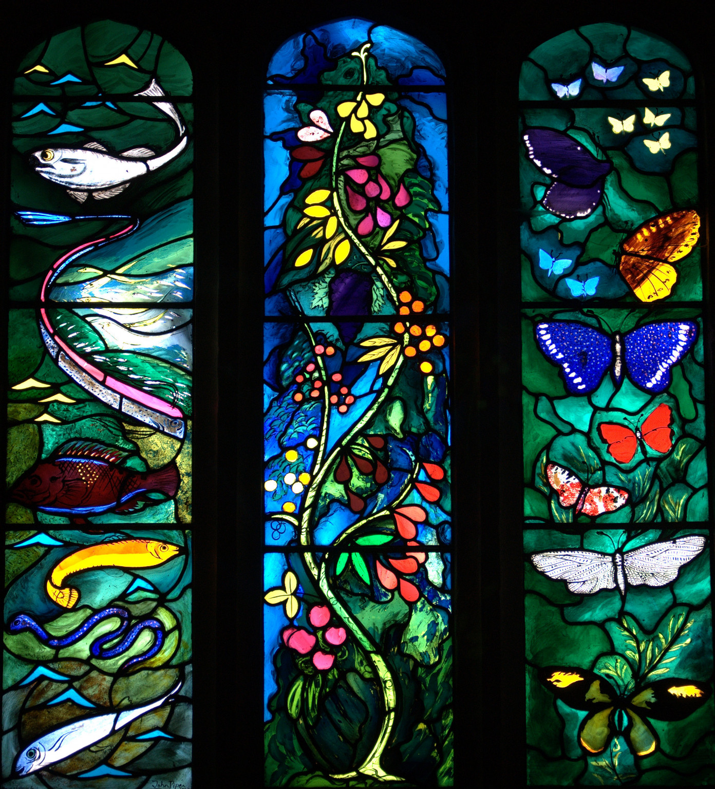 Stained glass window at All Saints Church, Farnborough, West Berkshire, featuring symbols of The  Resurrection: fishes; tree of life; butterflies. Designed by John Piper and made by Joseph Nuttgens.