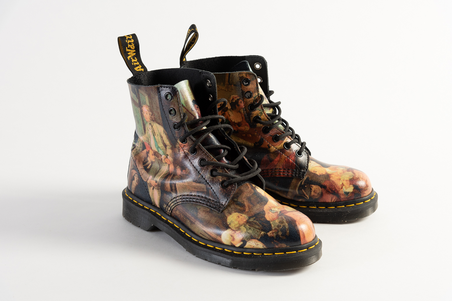 Leather boots printed with 'A Rake's Progress' by William Hogarth, 2015. Made by Dr Martens.